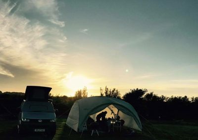 Sun sets over the campsite at Llanungar