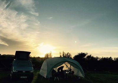 Sun sets over the campsite at Llanungar